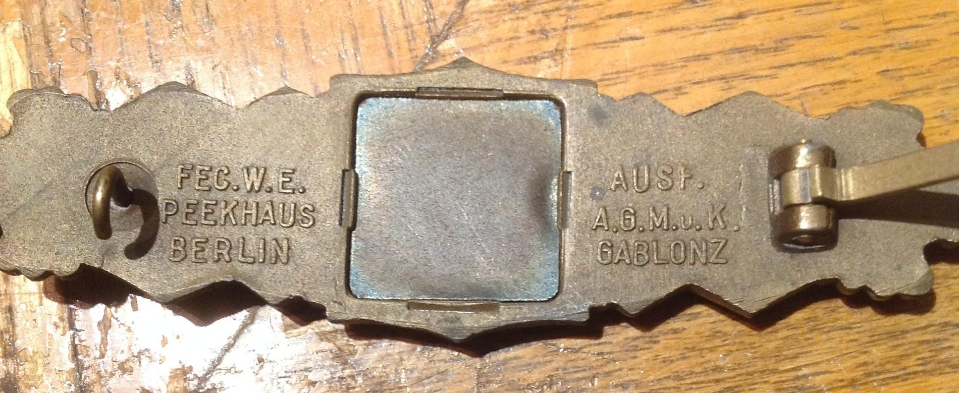 Nahkampfspange AGMUK en bronze 18061010192921840